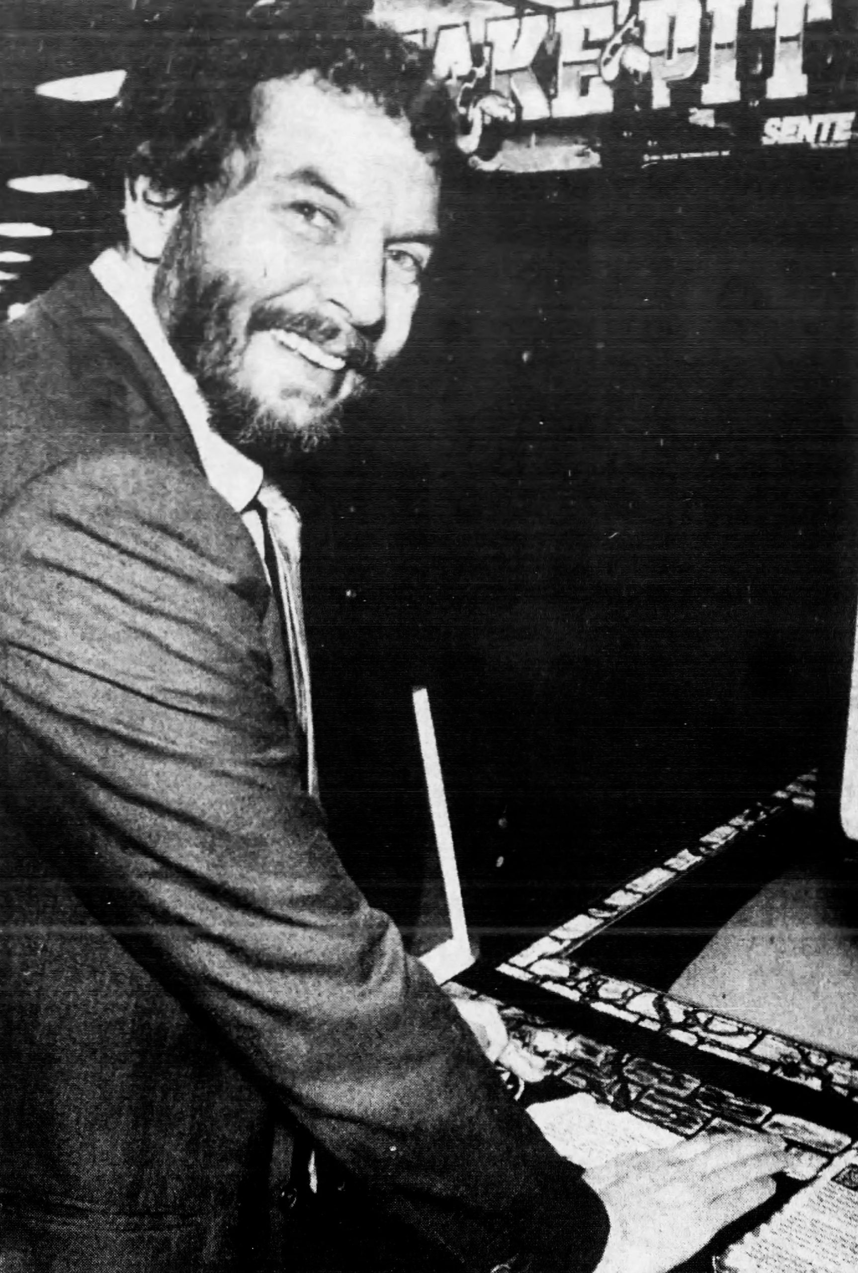 Atari founder Nolan Bushnell playing video arcade game Snake Pit, by Bally Sente