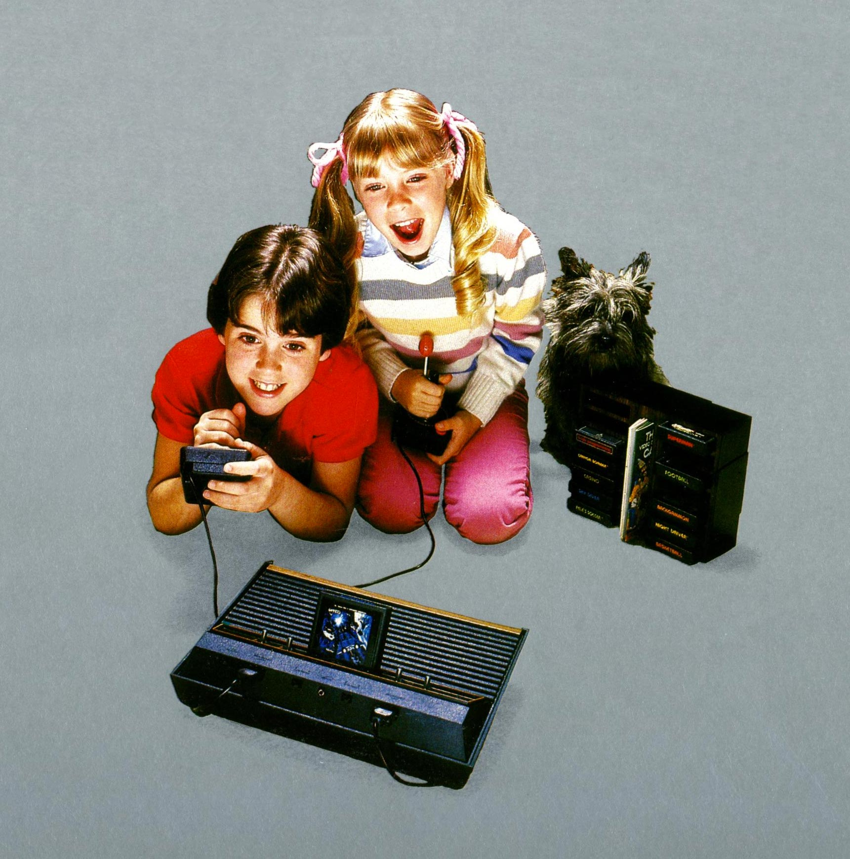 Kids playing the Atari 2600, a home video game console