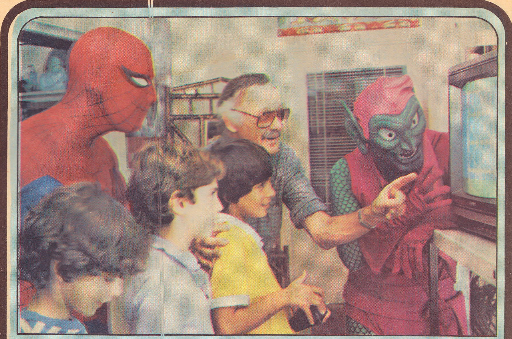 Stan Lee and kids play Spider-Man, a home video game cartridge for the VCS/2600, 1983