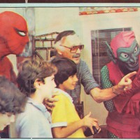 Stan Lee regals a group of kids, along with Spider-Man and Green Goblin