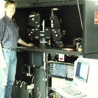 Photo of David Keller and a digital film printer used in the making of The Last Starfighter, a video game themed movie by Universal 1984