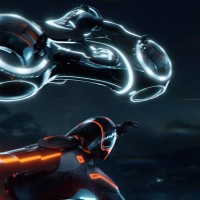 Still featuring a light cycle battle from Tron, a film by Disney 2010