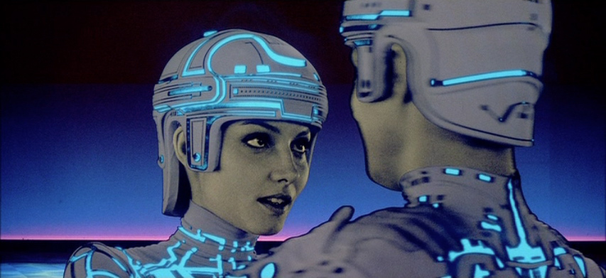 Still of Yori and Tron from Tron, a video game themed film by Disney 1982