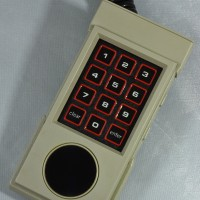 Controller for the Intellivision II, a home video game system by Mattel 1982