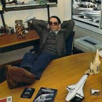 Older Kitchen brother Steve reclines among prototype models of the STS. 1984