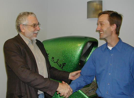 Photo of Nolan Bushnell and Pete Ashdown in front of Computer Space arcade video game