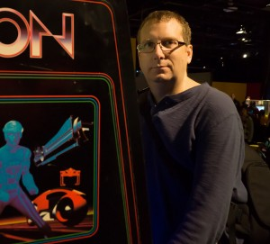 Photo of William Hunter playing arcade video game TRON
