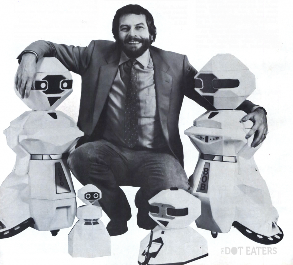Nolan Bushnell, founder of Atari, with some of his robotic creations from Androbot, 1983