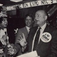 NYC mayor Ed Koch wearing button for the Coleco Adam home computer system
