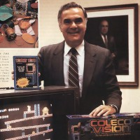 Image of Coleco President Arnold Greenberg with the ColecoVision, a home video game system from Coleco 1982
