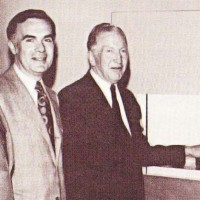 L. to R., Arnold Greenberg, NYSX official, Maurice Greenberg and Leonard Greenberg, circa 1971