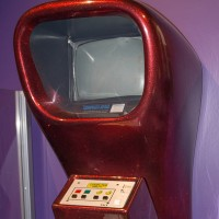Image of a red Computer Space cabinet, a coin-op video game by Syzygy/Nutting Associates 1971