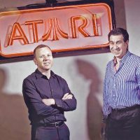 Atari Jim Wilson and Jeff Lapin, executives for the Atari video game company