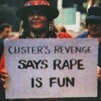 Image of a protester of Custer's Revenge, and adult video game by Mystique 1983