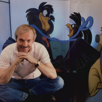 Animator Don Bluth, with NIMH characters behind, 1984