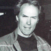 Actor Clint Eastwood with Firefox cabinet, a coin-op video game for the arcade, 1984