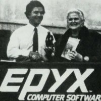 Epyx President Michael Katz gives Anne McCaffrey the first Dragonriders game off the assembly line, 1984