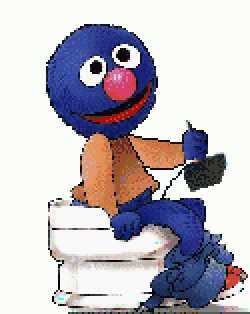 Grover sitting on a toilet, holding an Atari 2600 controller. See Links page for details.