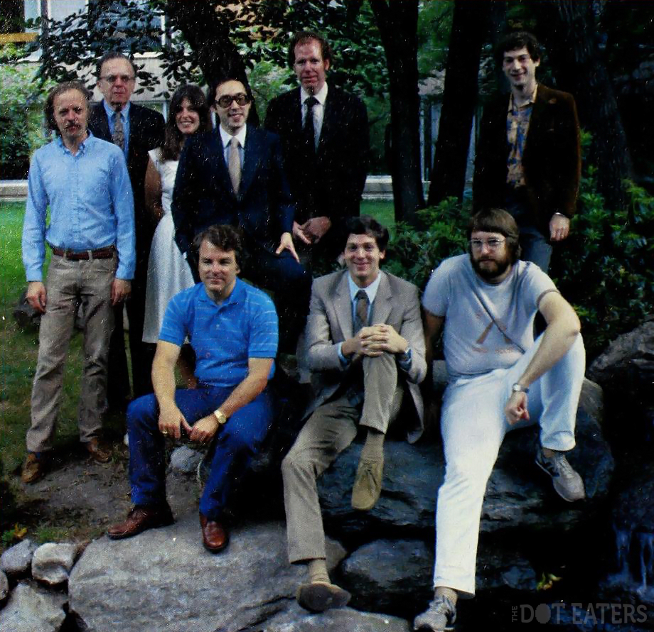 Infocom staff, 1982. Back row, L to R: Chris Reeve, J.C.R. Licklider, Gabrielle Accord, president Joel Berez, Scott Cutler, Michael Berlyn. Front row, L to R: Dave Lebling, Marc Blank, Steve Meretsky.