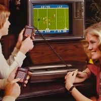 Promo shot of family playing NFL Football on the Mattel Intellivision video game console