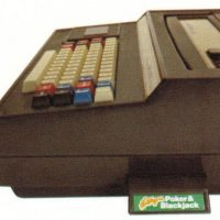 Game cartridge plugged into the side of the Keyboard Component for Intellivision, a video game system by Mattel