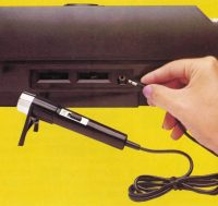 Microphone plugged into the Keyboard Component for Intellivision, a home video game system by Mattel