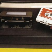 Cassette tape being inserted into the Keyboard Component for Intellivision, a video game system by Mattel