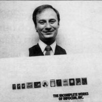 Mike Dornbrook holds an ad for computer text adventure game company Infocom