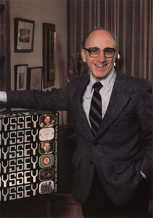 Ralph Baer and an Odyssey box, a home video game system by Magnavox 1972