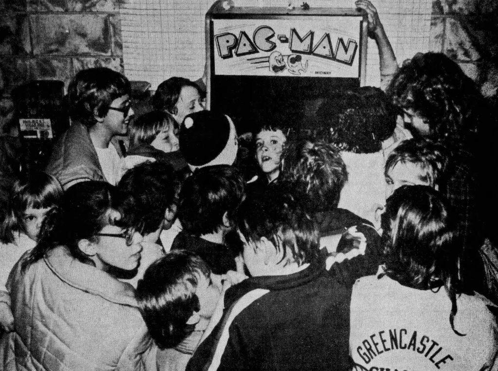 Crowd thronging arcade video game Pac-Man