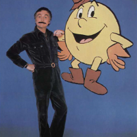 Image of Marty Ingels and Pac-Man, character from arcade video game by Namco/Midway 1982