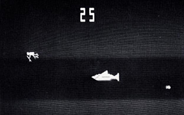 A screenshot from Shark Jaws, a video arcade game from Atari/Horror Games.