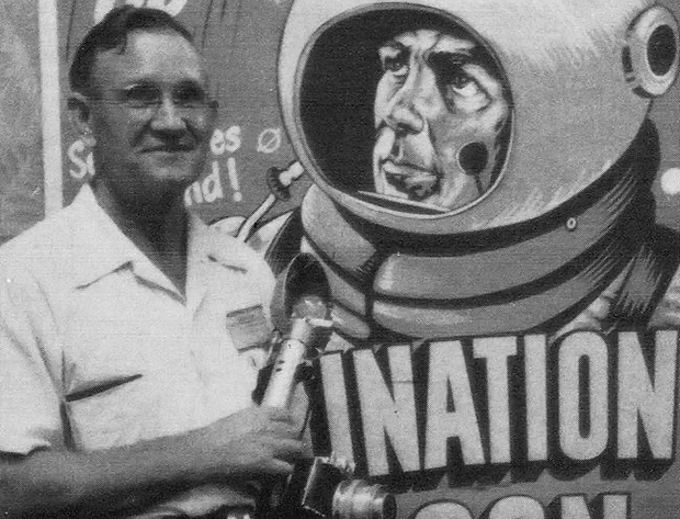 E.E. Smith in front of poster for Destination Moon, 1950E.E. Smith in front of poster for Destination Moon, 1950