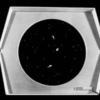 Image of Spacewar! running on a PDP-1 monitor