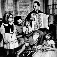 William Higinbotham, designer of the original video game, regaling his family with the accordion
