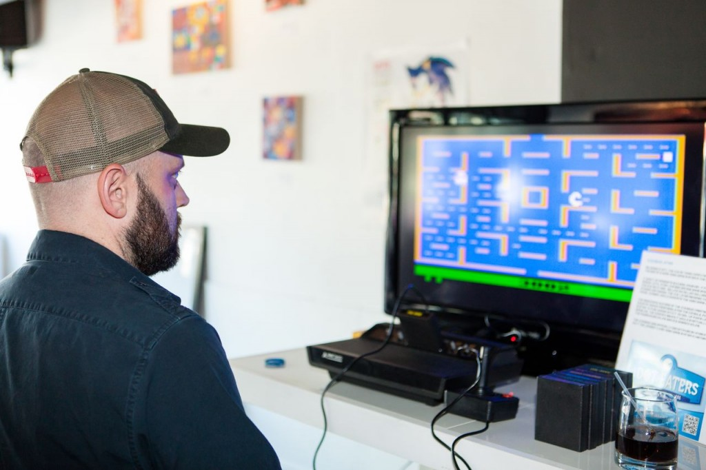 Playing Pac-Man, a home video game for the Atari VCS/2600