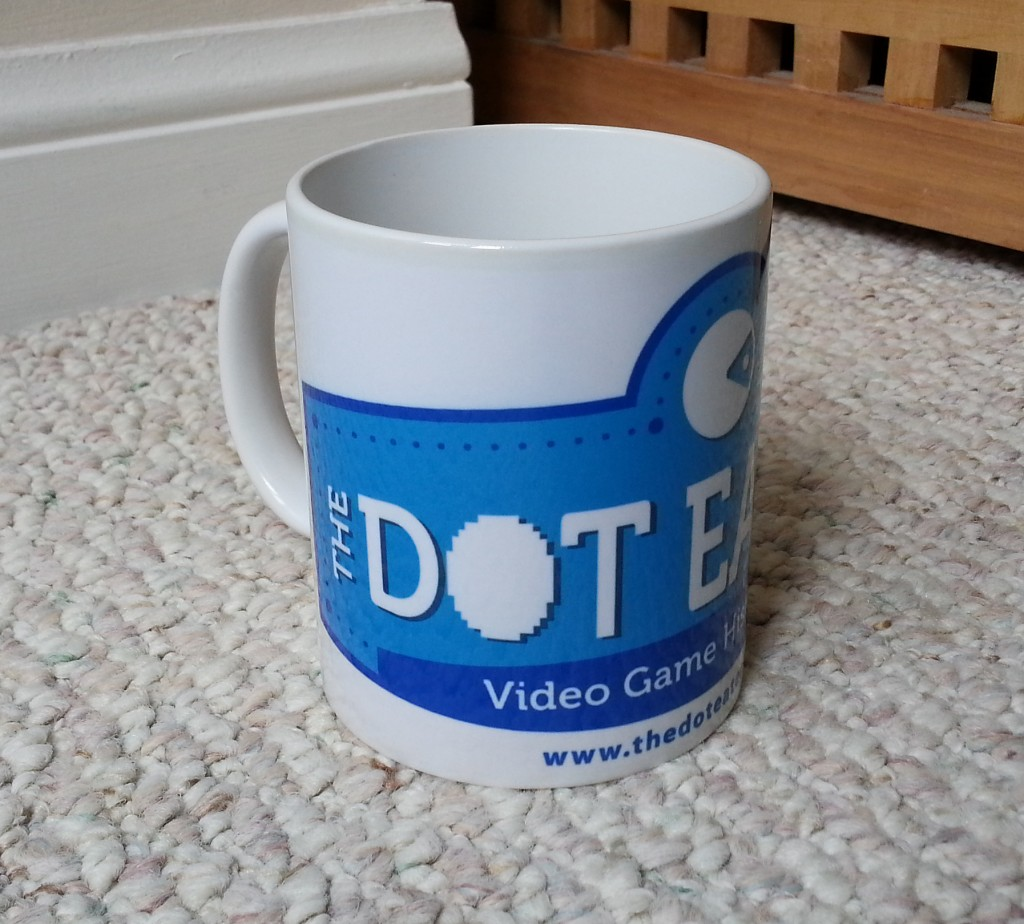 Image of a mug emblazoned with The Dot Eaters logo, a video game history website