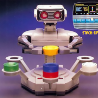 Rob the Robot playing Stack-Up, a video game for the Nintendo Entertainment System (NES)